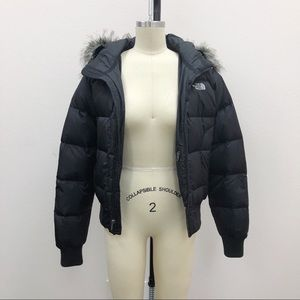 the north face goose down puffy jacket w fur trim.